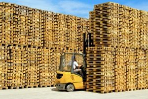 Forklift Operator Between Rows of Transport Pallets